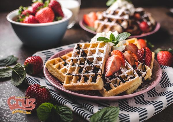 cruz waffles with berries, strawberries and chocolate